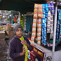 Sonny, age 14, works at a paan (tabacco) stall outside Shegaon's railway station. ..Photo: Tom Pietrasik.January 2011.Maharashtra, India