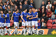 Oldham Athletic celebrate goal scored by Oldham Athletic forward Sam Surridge (9) to go 0-1 during the EFL Sky Bet League 2 match between Grimsby Town FC and Oldham Athletic at Blundell Park, Grimsby, United Kingdom on 15 September 2018.