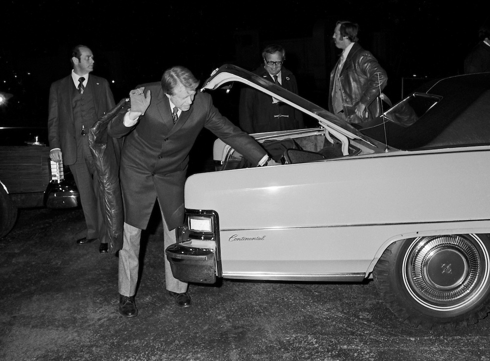 1976 Democratic nominee for President of the United States, Jimmy Carter on the campaign trail in the midwest. Carter fetches his luggage from a car trunk. Helping reinforce his reputation as an outsider and a common man, Carter refused to have others carry his bags. - To license this image, click on the shopping cart below -
