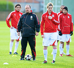 LIVERPOOL, ENGLAND - Tuesday, December 8, 2009: Liverpool's manager Rafael Benitez with Alberto Aquilani and Fernando Torres during a training session at Melwood ahead of the UEFA Champions League Group E match against AFC Fiorentina. (Pic by David Rawcliffe/Propaganda)