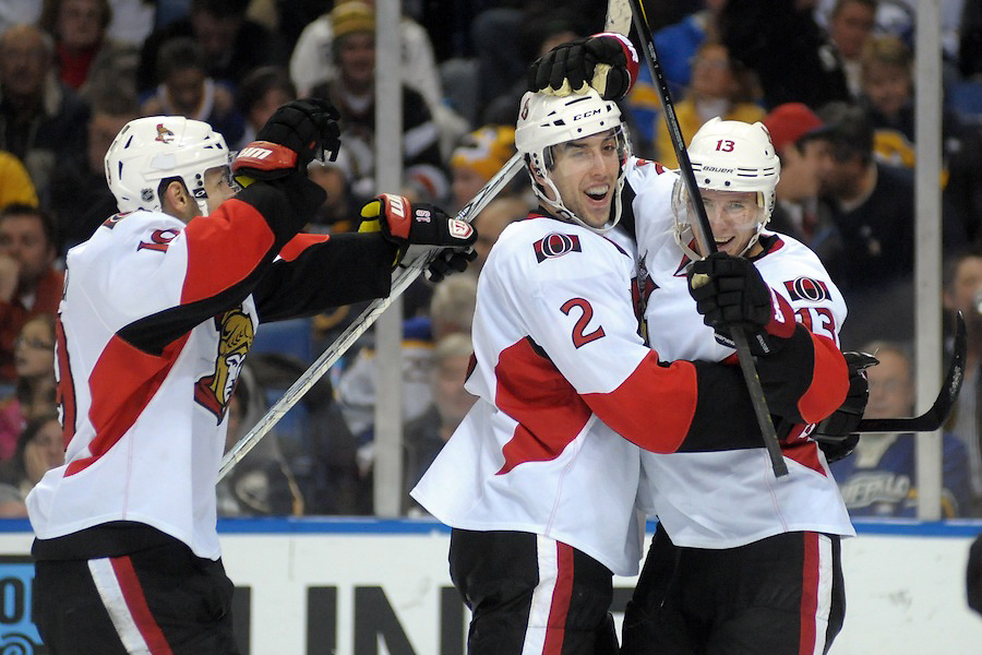 \Ottawa Senators defenseman Jared Cowen (2) celebrates with Ottawa Senators center Peter Regin (13) following the game winning goal over the Buffalo Sabres at the First Niagara Center in Buffalo, NY.  Ottawa defeated Buffalo 3-2 in overtime.