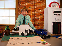 Aaron Day, 4th grade student at PSS, presents his Camper model equipped with lights during Makers Night at the Belknap Mill on Thursday evening.  (Karen Bobotas/for the Laconia Daily Sun)