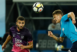 August 24, 2017 - Saint Petersburg, Russia - Oleg Shatov (R) of FC Zenit Saint Petersburg and Zakaria Labyad of FC Utrecht vie for the ball during the UEFA Europa League play-off round second leg match between FC Zenit St. Petersburg and FC Utrecht at Saint Petersburg Stadium on August 24, 2017 in Saint Petersburg, Russia. (Credit Image: © Mike Kireev/NurPhoto via ZUMA Press)