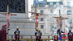 "© Licensed to London News Pictures. 19/04/2019. LONDON, UK.  Members of The Wintershall Players present their traditional ""The Passion of Jesus"" play in Trafalgar Square on Good Friday in front of huge crowds.  The play brings to life the events leading to the crucifixion of Jesus Christ, played by James Burke-Dunsmore (C), and his subsequent resurrection.  Photo credit: Stephen Chung/LNP"