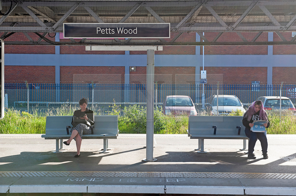 ©Licensed to London News Pictures 14/05/2020<br /> Petts Wood, UK. Two commuters waiting. Only a handfull of London commuters at Petts Wood train station in Petts Wood, South East London this morning due to the on going threat of Coronavirus. Photo credit: Grant Falvey/LNP