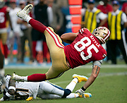 San Francisco 49ers tight end George Kittle (85) gets upended by Los Angeles Chargers defensive back Jahleel Addae (37) as he catches a second quarter pass for a gain of 13 yards and a first down at the Chargers 22 yard line during the NFL week 4 regular season football game against the Los Angeles Chargers on Sunday, Sept. 30, 2018 in Carson, Calif. The Chargers won the game 29-27. (©Paul Anthony Spinelli)