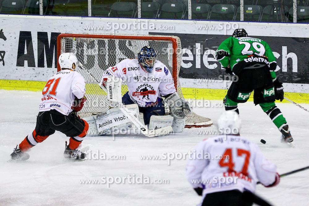 Anze Ropret of Olimpija and Aleksis Ahlqvist of Jesenice during ice hockey game between HDD Telemach Olimpija and SIJ Acroni Jesenice in 3rd leg of Finals of Slovenian National Championship 2015, on April 13, 2015 in Hala Tivoli, Ljubljana, Slovenia. Photo by Matic Klansek Velej / Sportida