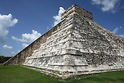 """The Pyramid of Kukulcan, called El Castillo (The Castle), 26 meters high, square base of 55,5 meters per side, each of the four sides, which represent the four cardinal points, is """"cut"""" in two by a staircase with 91 steps, Toltec architecture, 1100-1300 AD, Chichen Itza, Yucatan, Mexico. Picture by Manuel Cohen"""