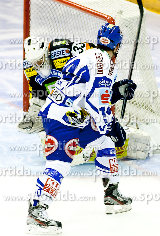 30.12.2011, Eisstadion Liebenau, Graz, AUT, EBEL, Moser Medical Graz 99ers vs EC Rekord Fenster VSV im Bild Frederic Cloutier (Moser Medical Graz 99ers, #33, Goalkeeper) und Derek Damon (EC Rekord Fenster VSV, #10, Forward) // during the Erste Bank Icehockey League, Eisstadion Liebenau, Graz, Austria, 2011-12-30, EXPA Pictures © 2011, PhotoCredit: EXPA/ E. Scheriau