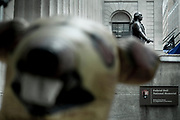 An inflatable Union rat sits outside the 100 Broadway building to draw attention to the bad conditions for the workers fixing the facade of the building. In the background is the statue of George Washington on the stairs of the Federal Hall, which housed the stock exchange on Wall Street before it moved across the street to todays NYSE Euronext Stock Exchange.