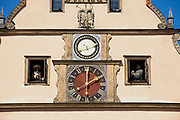 ROTHENBURG OB DER TAUBER, GERMANY - SEPTEMBER 06, 2010: Exterior of the famous medieval Meistertrunk mechanical clock at the historic town hall building in Rothenburg ob der Tauber, Germany.