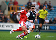 Chesterfield player Sam Morsy play a through ball under pressure from Millwall player Ben Thompson during the Sky Bet League 1 match between Millwall and Chesterfield at The Den, London, England on 29 August 2015. Photo by Bennett Dean.