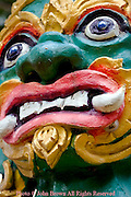 A colorful painted head is on display at a Buddhist temple in Chiang Rai, Thailand..
