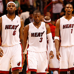 March 3, 2011; Miami, FL, USA; Miami Heat players small forward LeBron James (6), shooting guard Dwyane Wade (3) and power forward Chris Bosh (1) during the fourth quarter of a game against the Orlando Magic at the American Airlines Arena. The Magic defeated the Heat 99-96.    Mandatory Credit: Derick E. Hingle