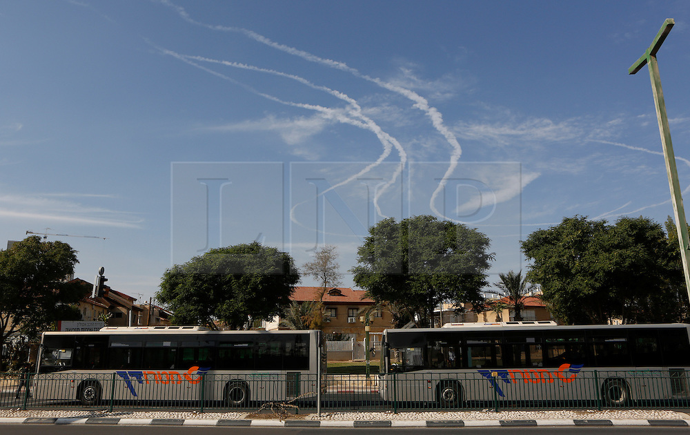 © Licensed to London News Pictures 20/11/2012.  Be'er Sheva, Israel.   Smoke trails line the sky of Be'er Sheva as the Israeli Army intercepts  rockets from Gaza this morning.  16 rockets were fired at the city.  A number of houses and a bus were damaged but there were no casualties.  Operation Pillar Cloud has now entered it's seventh day and talks are now underway for a ceasefire.  Later today, UN Secretary General Ban Ki-Moon will land in Israel for a round of meetings to try to broker a cease-fire.   Photo credit : Alison Baskerville/LNP