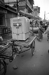 BANGLADESH DHAKA JUL94 - A photocopy machine stands loaded atop a bicycle rikshaw awaiting transport through the narrow streets of downtown Dhaka...jre/Photo by Jiri Rezac..© Jiri Rezac 1994