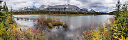 Spillway Lake reflects the Opal Range in Peter Lougheed Provincial Park, Kananaskis Country, Alberta, Canada. Kananaskis Country is a park system in the Canadian Rockies west of Calgary. This panorama was stitched from 11 overlapping photos.