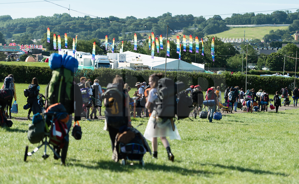 © Licensed to London News Pictures. 24/06/2015. Pilton, UK.   Festival goers at Glastonbury Festival rush to find the best area to set up their tents shortly after entering the site at 8am on  Wednesday Day 1 of the festival.        The pedestrian gates to the festival opened at 8am this morning, with many festival goers arriving and waiting throughout last night for the opening.  This years headline acts include Kanye West, The Who and Florence and the Machine, the latter having been upgraded in the bill to replace original headline act Foo Fighters.  Photo credit: Richard Isaac/LNP