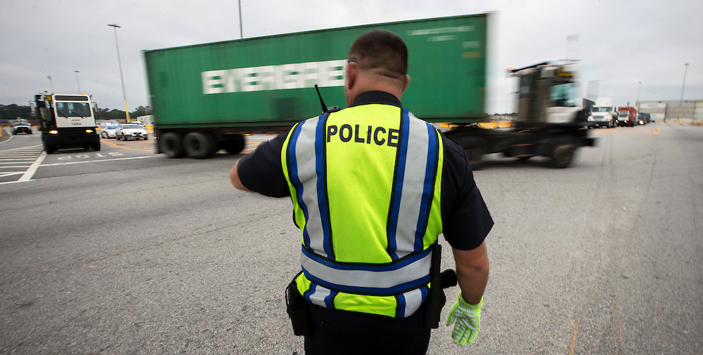 Port Police officers control traffic at various locations at the Port of Savannah in Georgia Ports Authority Garden City Terminal, Friday, July, 24 2015, in Savannah, Ga.  (GPA Photo/Stephen B. Morton)