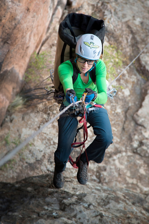 """Kate Rutherford jumaring up the last section of """"Tague Yer Time,"""" 12b, South Rim, Black Canyon of the Gunnison, Colorado."""