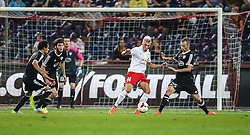 06.08.2014, Red Bull Arena, Salzburg, AUT, UEFA CL Qualifikation, FC Red Bull Salzburg vs Qarabag FK, dritte Runde, Rueckspiel, im Bild Kevin Kampl, (FC Red Bull Salzburg, #44) und Ansi Agolli, (Qarabag FK, #25) //during UEFA Champions League Qualifier second leg 3rd round match between FC Red Bull Salzburg vs Qarabag FK at the Red Bull Arena in Salzburg, Austria on 2014/08/06. EXPA Pictures © 2014, PhotoCredit: EXPA/ Roland Hackl