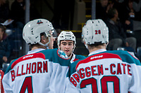 KELOWNA, CANADA - FEBRUARY 20: Dillon Dube #19 skates to Gordie Ballhorn #4 and Conner Bruggen-Cate #20 of the Kelowna Rockets to celebrate a first period goal against the Prince George Cougars  on February 20, 2018 at Prospera Place in Kelowna, British Columbia, Canada.  (Photo by Marissa Baecker/Shoot the Breeze)  *** Local Caption ***