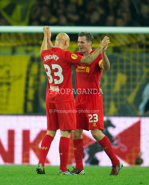 BERNE, SWITZERLAND - Thursday, September 20, 2012: Liverpool's captain Jamie Carragher and two-goal hero Jonjo Shelvey celebrate their 5-3 victory over BSC Young Boys during the UEFA Europa League Group A match at the Wankdorf Stadion. (Pic by David Rawcliffe/Propaganda)