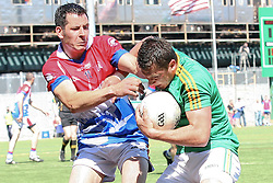 May 5, 2013; Bronx, NY; USA; Leitrim's Paul Brennan (10) and New York's Jason Kelly (11) battle for the ball during the first half at Gaelic Park.
