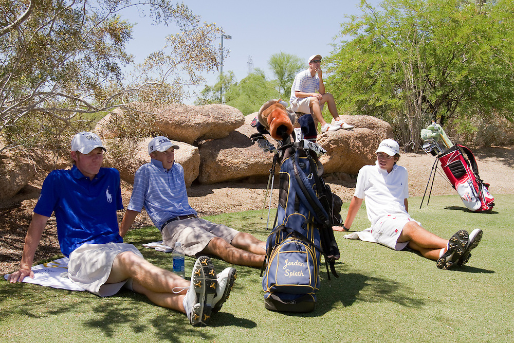 American Junior Golf Association players, including Jordan Spieth, second from left, wait in the shade at the Thunderbird International Junior tournament.  Grayson Murray (dark blue shirt), Andrew Knox (striped shirt) and Billy Kennerly (all white) at the Thunderbird International Junior tournament.