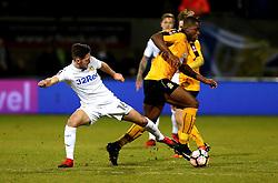 Uche Ikpeazu of Cambridge United goes past Matt Grimes of Leeds United - Mandatory by-line: Robbie Stephenson/JMP - 09/01/2017 - FOOTBALL - Cambs Glass Stadium - Cambridge, England - Cambridge United v Leeds United - FA Cup third round