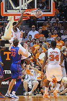 Jan 7, 2012; Knoxville, TN, USA; Tennessee Volunteers forward Kenny Hall (20) dunks the ball against Florida Gators forward Erik Murphy (33) during the game at Thompson Boling Arena. Tennessee won 67 to 56. Mandatory Credit: Randy Sartin-US PRESSWIRE