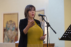 © Licensed to London News Pictures. 26/05/2016. LONDON, UK.  JESS PHILLIPS MP speaking at the launch of 'East End Women: The Real Story' exhibition at St George-in-the-East church in Shadwell. The exhibition is a response by the East End Women's Collective and 38 Degrees following a series of protests against the nearby controversial Jack the Ripper museum, which had promised to celebrate east end women, but activists opposed and claimed glorified violence against women. A number of feminist groups and activists are still campaigning to get the  Jack the Ripper museum closed. The exhibition runs until 9th July 2016.  Photo credit: Vickie Flores/LNP