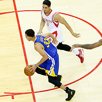 23 May 2015: Golden State Warriors guard Stephen Curry (30) drives past Houston Rockets forward Josh Smith (5) and Houston Rockets guard Nick Johnson (3) during the Golden State Warriors 115-80 victory over the Houston Rockets, in game 3 of the Western Conference finals, at the Toyota Center, Houston, Texas, USA.