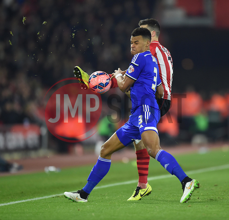 Southampton's Shane Long and Ipswich Town's Tyrone Mings tussle to keep the ball in play - Photo mandatory by-line: Paul Knight/JMP - Mobile: 07966 386802 - 04/01/2015 - SPORT - Football - Southampton - St Mary's Stadium - Southampton v Ipswich Town - FA Cup Third Round