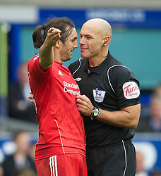 LIVERPOOL, ENGLAND - Sunday, October 17, 2010: Liverpool's Sotirios Kyrgiakos and referee Howard Webb during the 214th Merseyside Derby match against Everton at Goodison Park. (Photo by David Rawcliffe/Propaganda)