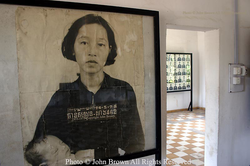 "A photograph of the wife of a former government official holding a baby is among the hundreds of portraits on display at Tuol Sleng Genocide Museum in Phnom Penh, Cambodia.  The images depict Khmer and foreign detainees who were subject to extreme brutality prior to their ultimate deaths at Choun Eak, also known as ""The Killing Fields"". More than 8000 people were denied fair trials while they were imprisoned at Tuol Sleng during Pol Pot's Khmer Rouge regime, which lasted from 1975-1979."