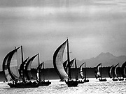 Sails billowed as boat crews set canvas and secured lines at the start of the Great Equalizer race on Puget Sound off Shilshole. (Josef Scaylea / The Seattle Times, 1977)