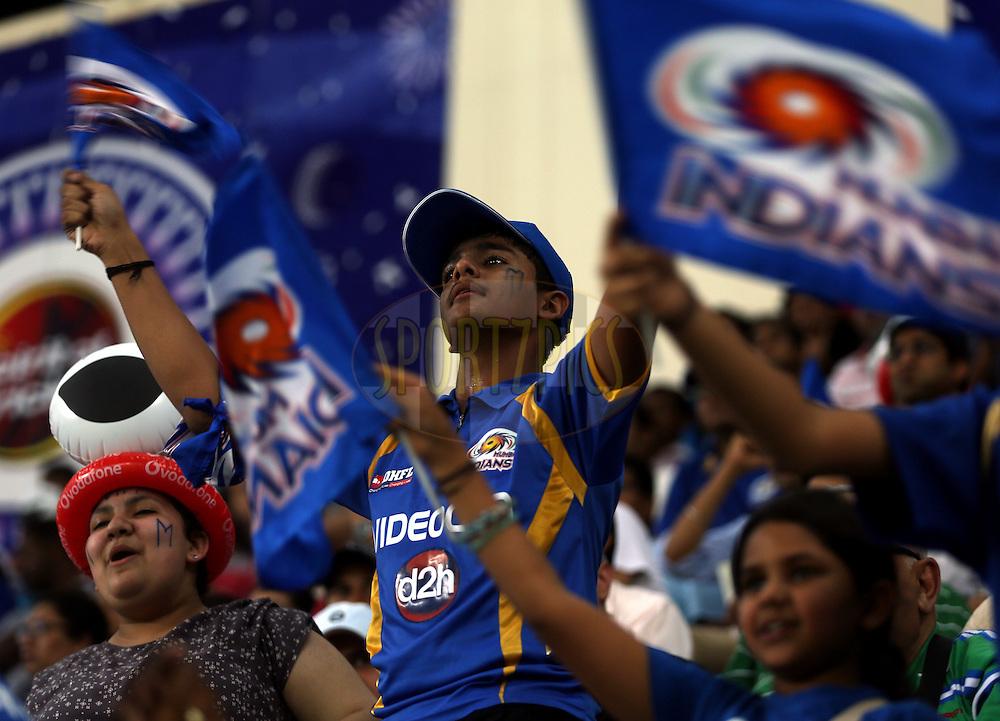 Fan's Enjoys during match 20 of the Pepsi Indian Premier League Season 2014 between the Mumbai Indians and the Sunrisers Hyderabad held at the Dubai International Stadium, Dubai, United Arab Emirates on the 30th April 2014<br /> <br /> Photo by Sandeep Shetty / IPL / SPORTZPICS