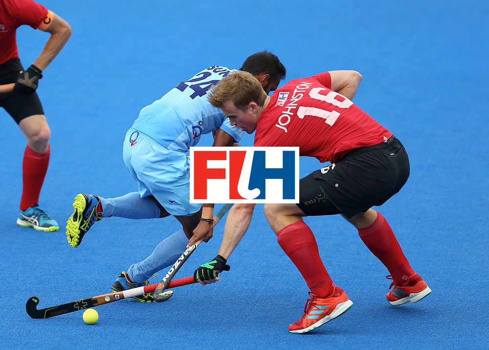 LONDON, ENGLAND - JUNE 25: Gordan Johnston of Canada and Sunil Sowmarpet of India battle for possession during the 5th/6th place match between India and Canada on day nine of the Hero Hockey World League Semi-Final at Lee Valley Hockey and Tennis Centre on June 25, 2017 in London, England. (Photo by Steve Bardens/Getty Images)