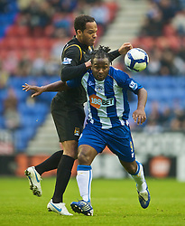 WIGAN, ENGLAND - Sunday, October 18, 2009: Manchester City's Joleon Lescott and Wigan Athletic's Jason Scotland during the Premiership match at the JJB Stadium. (Pic by David Rawcliffe/Propaganda)