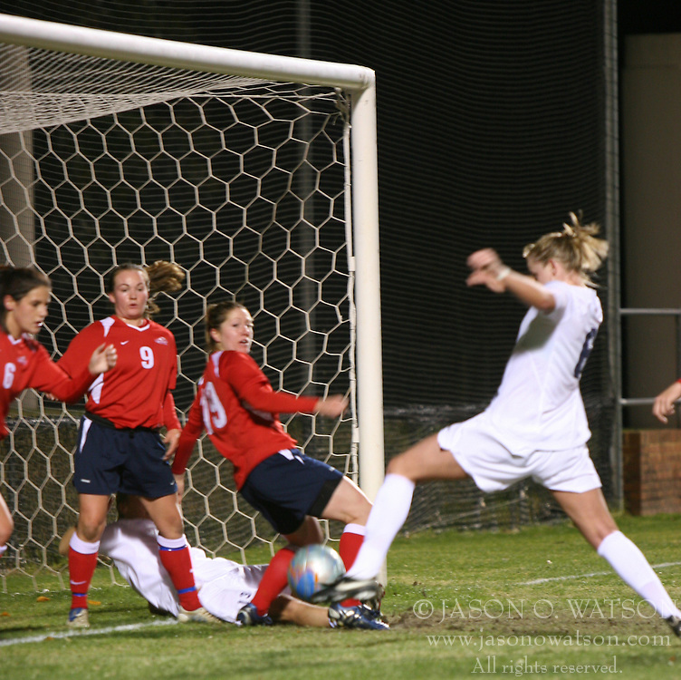 Julia Falk (6) takes a shot on goal against Liberty.  Falk scored earlier in the match to help UVA towards a 4-0 win over LU in the first round of the NCAA tournament.
