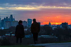 London, November 30 2017. Walkers enjoy the view as the sun rises over the London skyline, seen from Primrose Hill, on a chilly London morning when overnight temperatures plunged to below freezing. © Paul Davey