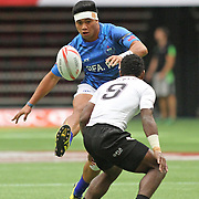 Samoa plays kick and chase inorder to catch up with Fiji.  Fiji won 38-5.  Canada 7's Vancouver, British Columbia, Day 1.   Photo by Barry Markowitz, 4/12/16, 10:30 am