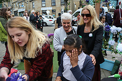 © Licensed to London News Pictures. 16/06/2017. Birstall, UK. Jo Cox's mother Jean Leadbeater and sister Kim Leadbeater talk to members of the community in Birstall town square where the Labour MP was murdered a year ago today. Events are planned to take place across the country this weekend in memory of Jo Cox in what is being called 'The Great Get Together'. Credit: Ian Hinchliffe Photo credit : Ian Hinchliffe/LNP