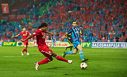 TRABZON, TURKEY - Thursday, August 26, 2010: Liverpool's Glen Johnson send the ball in for the own-goal equaliser against Trabzonspor during the UEFA Europa League Play-Off 2nd Leg match at the Huseyin Avni Aker Stadium. (Pic by: David Rawcliffe/Propaganda)