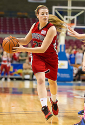 Bridgeport guard Hope Chalfant (23) dribbles to ball against Fairmont Senior during a first round game at the Charleston Civic Center.