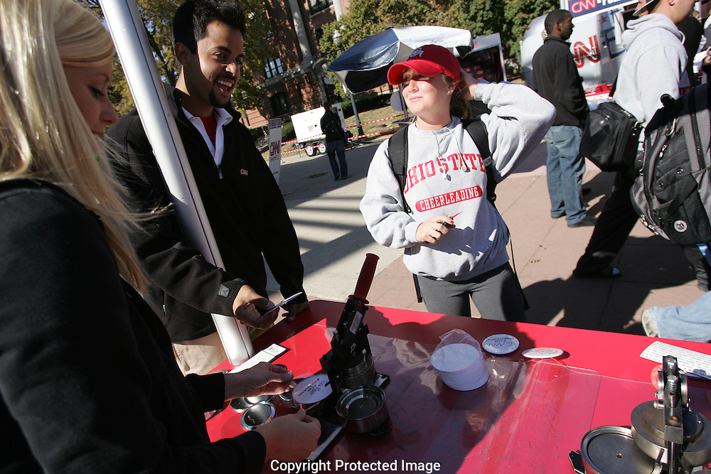 OSU student Christina Meier, center, talks with CNN volunteers while she waits for her free button to be made Tuesday October 21, 2008 during CNN?s Election Express Yourself Tour in Columbus on the campus of Ohio State..