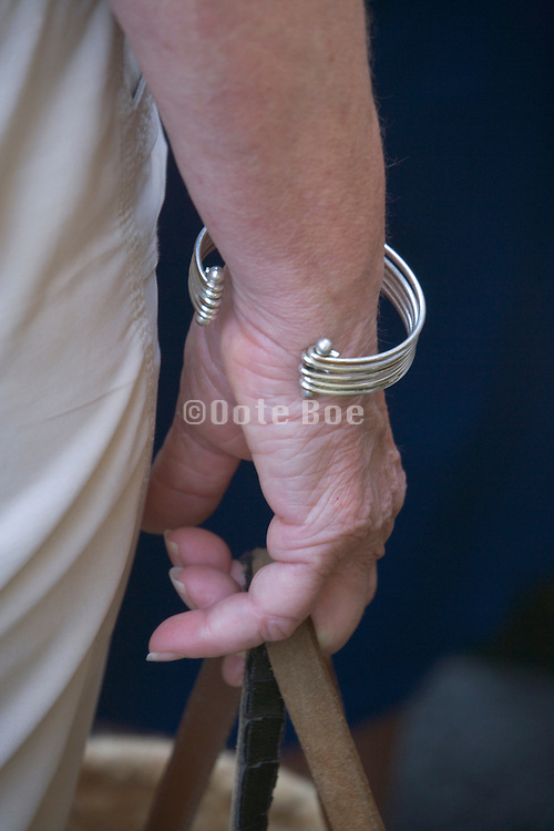 hand of an elderly woman holding her shopping bag casual
