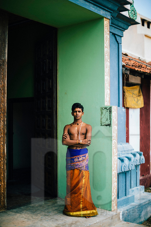Portrait of a young Hindu caretaker at the Kannakai Amman Temple on Punkudutivu island on the Jaffna Peninsula, Sri Lanka, Asia