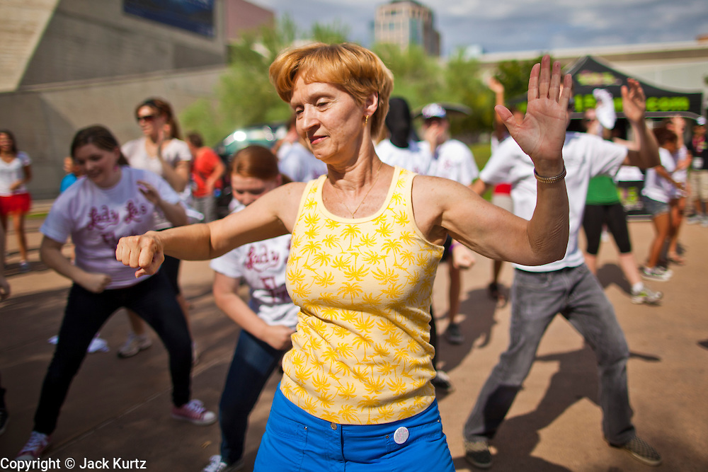 "30 JULY 2011 - PHOENIX, AZ:  REGINA PRYOR, from Tempe, AZ, dances as a part of a flash mob in Phoenix, AZ, Saturday. About 200 people showed up at Heritage Square in downtown Phoenix Saturday morning for a flash mob coordinated by the Arizona Science Center. The mob danced to several hip-hop songs before disbanding. The event was a part of National Dance Day Activities and the First Lady's ""Let's Move!"" physical fitness campaign.    PHOTO BY JACK KURTZ"